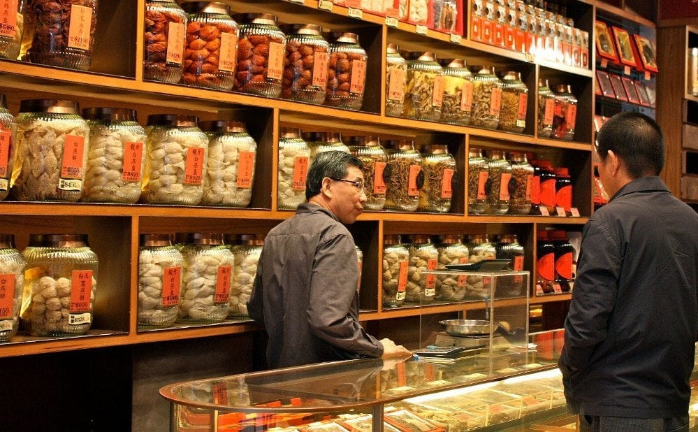 Best way: photo of a Traditional Chinese Medicine specialist shop in Hong Kong.