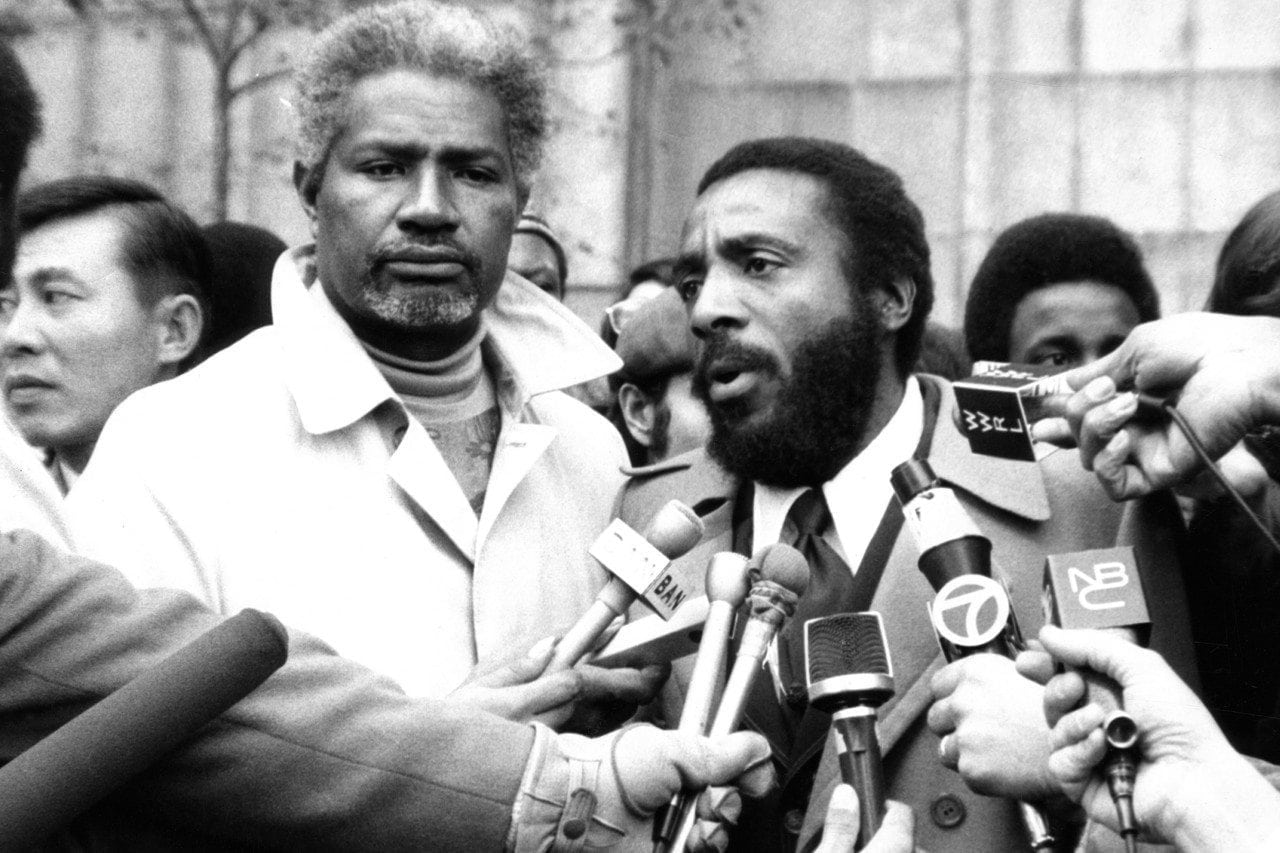 Photo of Dick Gregory and Ossie Davis trying to get something done in America.