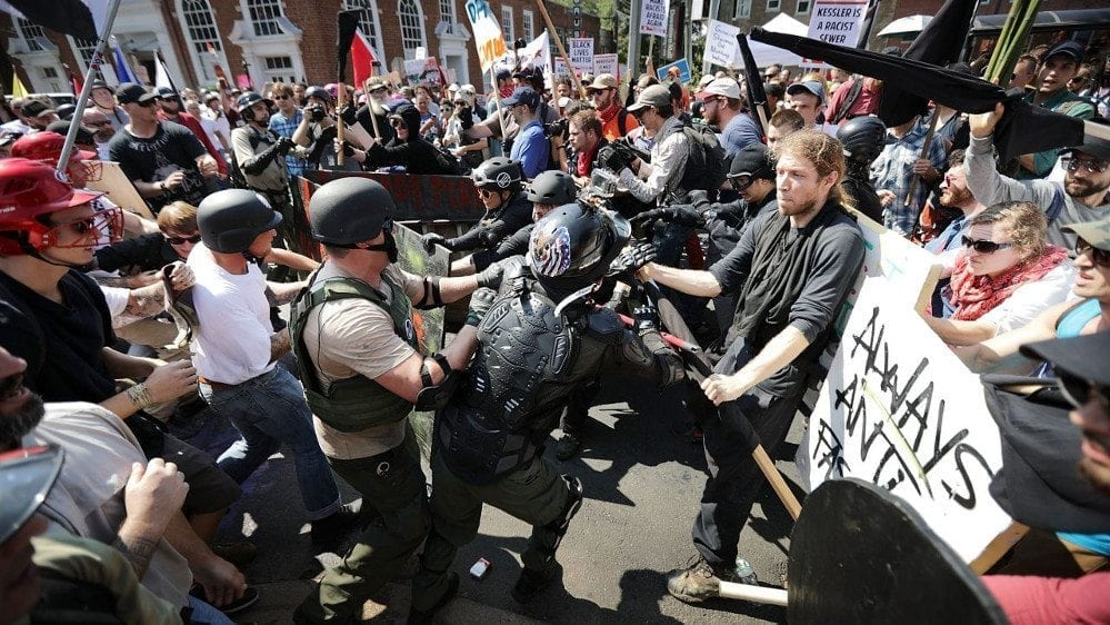 Rude: photo of protestors classhing at Unite the Right rally on August 12, 2017, in Charlottesville, Virginia.